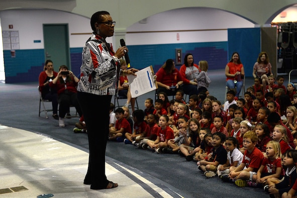 "Willette Horne-Barnes, Andersen Elementary School principal, speaks to students about the importance of drug abuse prevention during a Red Ribbon Week presentation Oct. 28, 2015, at Andersen Air Force Base, Guam. The 2015 Red Ribbon Week campaign's slogan was ""respect yourself, be drug free."" (U.S. Air Force photo by Airman 1st Class Alexa Ann Henderson/Released)"