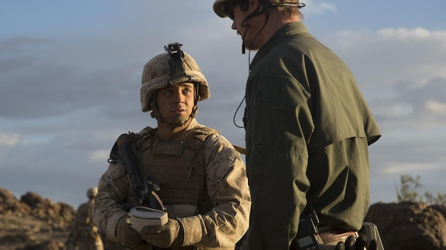 Lance Corporal John Roan, left, a squad leader with E Company, 2nd Battalion, 2nd Marine Regiment positively identified an improvised explosive device just before speaking with one of the instructors during Integrated Training Exercise 1-16 at Marine Air Ground Combat Center, Twentynine Palms, Calif., Oct. 29, 2015. Marines at ITX demonstrate core infantry mission essential tasks while conducting offensive and defensive operations.