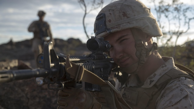 Lance Corporal Tyler Miller, a rifleman with E Company, 2nd Battalion, 2nd Marine Regiment posts security during Integrated Training Exercise 1-16 at Marine Air Ground Combat Center, Twentynine Palms, Calif., Oct. 29, 2015. Marines at ITX demonstrate core infantry mission essential tasks while conducting offensive and defensive operations.