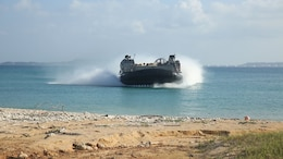 A landing craft air cushion-class hovercraft approaches Kin Blue, Okinawa, Japan, for a beach landing exercise, Oct. 27, 2015, during Blue Chromite 2016. Blue Chromite is a large-scale, cost effective on-island training event lead by 4th Marine Regiment, 3rd Marine Division, III Marine Expeditionary Force.
