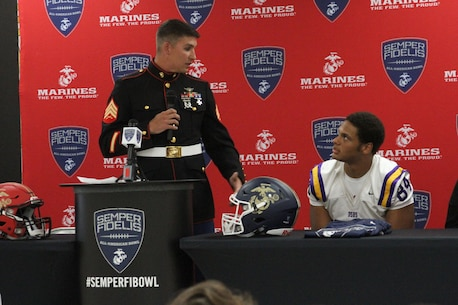 Sergeant Wesley Martins, a canvassing recruiter with Recruiting Sub-Station Baton Rouge North, speaks during the Semper Fidelis All-American Bowl jersey presentation for Caleb Roddy at Denham Springs High School Oct. 16, 2015. Roddy will be participating in the fifth annual Semper Fi Bowl taking place in Carson, California on Jan. 3, 2016.