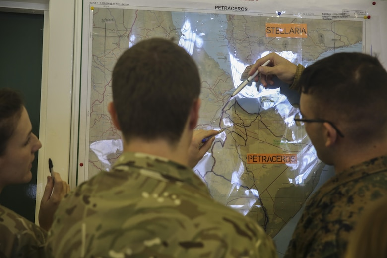 U.S. Marines with 2nd Intelligence Battalion and British soldiers search for a location on a map during Exercise Phoenix Odyssey II in Edinburgh, U.K., Oct. 27, 2015. The British and U.S. are collaborating for the second consecutive year in order to enhance joint intelligence operations. (U.S. Marine Corps photo by Cpl. Lucas Hopkins/Released)