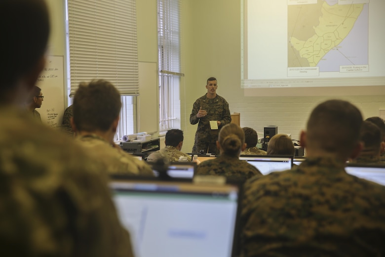 U.S. Marine 1st Lt. Benton Pittman, an air intelligence officer with 2nd Intelligence Battalion, gives a brief to Marines and British soldiers during Exercise Phoenix Odyssey II in Edinburgh, U.K., Oct. 27, 2015. The second iteration of EPO is designed to build the partnerships and joint intelligence capabilities between the two services. (U.S. Marine Corps photo by Cpl. Lucas Hopkins/Released)