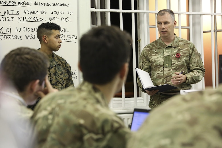 A British soldier briefs other soldiers and U.S. Marines with 2nd Intelligence Battalion during Exercise Phoenix Odyssey II in Edinburgh, U.K., Oct. 28, 2015. The nations are collaborating for the two-week exercise in order to increase intelligence proficiencies while working in joint scenarios. (U.S. Marine Corps photo by Cpl. Lucas Hopkins/Released)