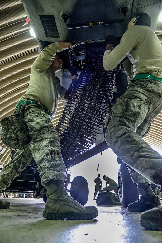 Staff Sgt.Woodrow Walkup and Senior Airman Kameron Whitener, 25th Aircraft Maintenance Unit weapons load crew team members, prepare to load 30 millimeter rounds onto an A-10 Thunderbolt II during the Vigilant Ace 16 exercise on Osan Air Base, Republic of Korea, Nov. 1, 2015. The A-10 is a highly accurate and survivable weapons-delivery platform, capable of carrying up to 16,000 pounds of munitions including the 30 millimeter cannon which can penetrate tanks. (U.S. Air Force photo/Senior Airman Kristin High)
