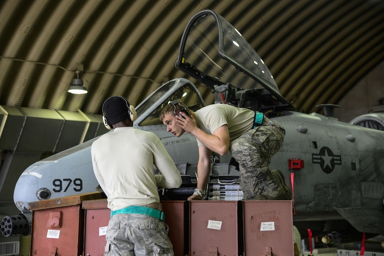 Senior Airman Kameron Whitener and Airman 1st Class Brandon Jones, 25th Aircraft Maintenance Unit weapons load crew team members, prepare to load 30 millimeter rounds onto an A-10 Thunderbolt II during the Vigilant Ace 16 exercise on Osan Air Base, Republic of Korea, Nov. 1, 2015. Each team has three Airmen who are all responsible for different portions of the load. The one-man is the supervisor, the two-man is responsible for tools and aircraft preparation and the three-man is responsible for driving the jammer and munitions preparation. Without each member, the crews would not be able to properly load munitions in the safest way possible. (U.S. Air Force photo/Senior Airman Kristin High)
