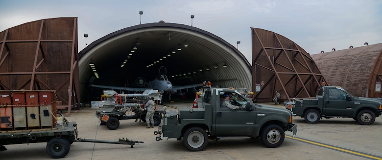 Weapons load crew team Airmen from the 25th Aircraft Maintenance Unit prepare to load munitions onto A-10 Thunderbolt IIs during the Vigilant Ace 16 exercise on Osan Air Base, Republic of Korea, Nov. 1, 2015. The munitions Airmen can load up to 16,000 pounds of mixed ordnance onto the A-10 airframe. The A-10 is powered by two General Electric TF34-GE-100 turbofan engines producing 9,065 pounds of thrust each, and the A-10 is capable  of reaching speeds of 450 nautical miles per hour. (U.S. Air Force photo/Senior Airman Kristin High)