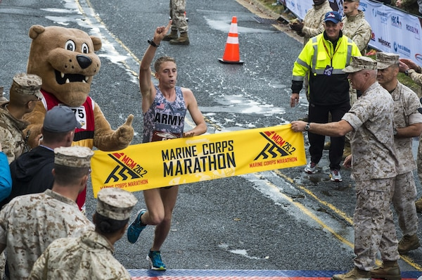 """Overall winner of the 40th Marine Corps Marathon, U.S. Army Lt. Trevor Lafontaine, runs through the finish line of his first marathon at 2:24:25 in Arlington, Va., Oct. 25, 2015. Also known as """"The People's Marathon,"""" the 26.2 mile race drew roughly 30,000 participants to promote physical fitness, generate goodwill in the community, and showcase the organizational skills of the Marine Corps. (U.S. Marine Corps photo by Staff Sgt. Sarah R. Hickory/Released)"""