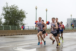 """Two members of the U.S. Army Running Team, Trevor LaFontaine (#54) from Cornwall, N.Y., and Daniel Schlich (#55), from Saint Robert, Mo., cross the Francis Scott Key Bridge during the 40th Marine Corps Marathon near the 4-mile mark from Arlington, Va. into Georgetown in Washington, D.C., Oct. 25, 2015. LaFontaine, participating in his first marathon, went on take the first place male and overall win with a finish time of 2:24:25. Also known as """"The People's Marathon,"""" the 26.2 mile race drew roughly 30,000 participants to promote physical fitness, generate goodwill in the community, and showcase the organizational skills of the Marine Corps. (U.S. Marine Corps photo by Kathy Reesey/Released)"""
