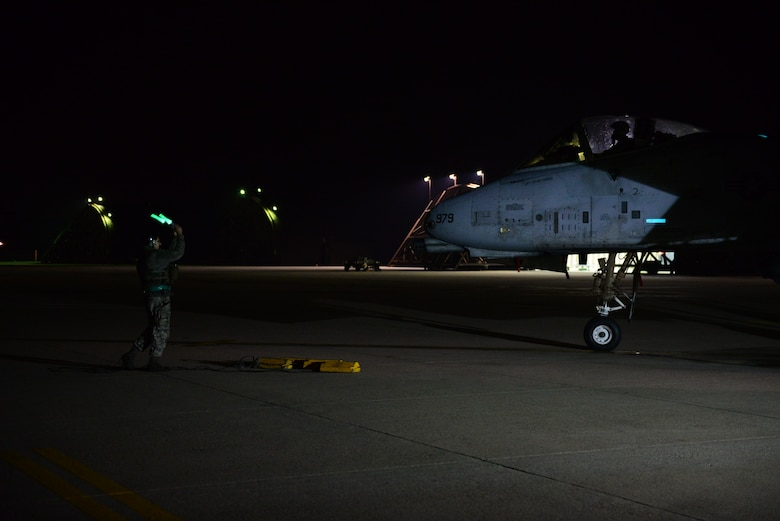 An A- 10 Thunderbolt II taxis in on the first night of Vigilant Ace 16 at Osan Air Base, Republic of Korea, Nov 2, 2015. Vigilate Ace is a peninuslas wide operational readiness exercise focused on strengthening the ROK/US alliance.  (U.S. Air Force photo/Staff Sgt. Amber Grimm)