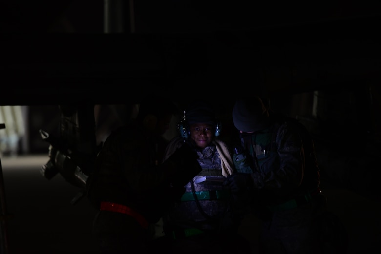 Staff Sgt. Tamika Lindsey, 25th Aircraft Maintenance Unit load master, reviews system operational guidelines with her crew during the first night of Vigilant Ace 16 at Osan Air Base, Republic of Korea, Nov. 2, 2015. Vigilant Ace is a peninusla wide operational readiness exercise geared toward strengthing the interoperability of the ROK/U.S.  alliance