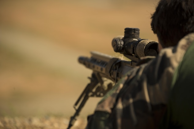 A Marine with Company C, 1st Marine Raider Battalion, U.S. Marine Corps Forces, Special Operations Command fires at distant, static targets during a Company Collective Exercise aboard Marine Corps Base Camp Pendleton, Calif., Oct. 7, 2015. Marine Special Operations Company C spent the first phase of their three-phase Company Collective Exercise practicing Foreign Internal Defense aboard Marine Corps Base Camp Pendleton, Calif., Oct. 5-8.