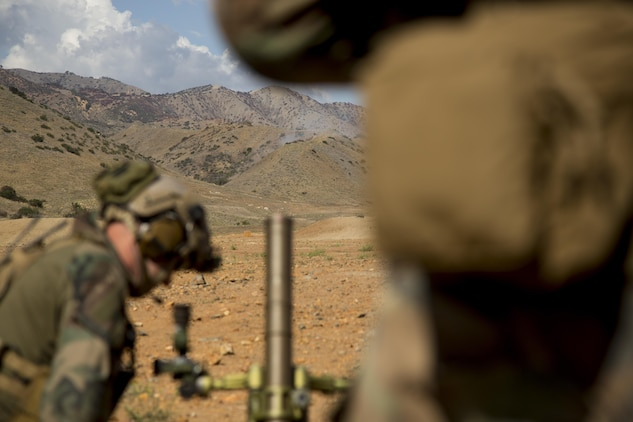 Marines with 1st Marine Raider Battalion fire 60 mm mortars during a Company Collective Exercise aboard Marine Corps Base Camp Pendleton, Calif., Oct. 7, 2015. Marine Special Operations Company C, 1st Marine Raider Battalion, U.S. Marine Corps Forces, Special Operations Command spent the first phase of their three-phase Company Collective Exercise practicing Foreign Internal Defense aboard Marine Corps Base Camp Pendleton, Calif., Oct. 5-8.