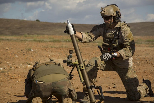 A U.S. Air Force Pararescue Jumper prepares to fire a 60 mm mortar round during a Company Collective Exercise aboard Marine Corps Base Camp Pendleton, Calif., Oct. 7, 2015. Marine Special Operations Company C, 1st Marine Raider Battalion, U.S. Marine Corps Forces, Special Operations Command spent the first phase of their three-phase Company Collective Exercise practicing Foreign Internal Defense aboard Marine Corps Base Camp Pendleton, Calif., Oct. 5-8.