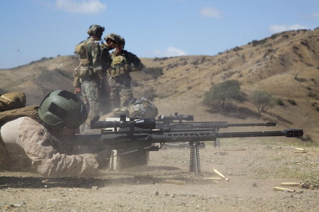 A Marine with 1st Marine Raider Battalion fires a .50 caliber Special Application Scoped Rifle during a Company Collective Exercise aboard Marine Corps Base Camp Pendleton, Calif., Oct. 7, 2015. Marine Special Operations Company C, 1st Marine Raider Battalion, U.S. Marine Corps Forces, Special Operations Command spent the first phase of their three-phase Company Collective Exercise practicing Foreign Internal Defense aboard Marine Corps Base Camp Pendleton, Calif., Oct. 5-8.
