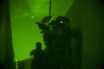 Marines with Company C, 1st Marine Raider Battalion, U.S. Marine Corps Forces, Special Operations Command maneuver on foot from building to building during a night raid aboard Marine Corps Base Camp Pendleton, Calif., Oct. 9, 2015. Marine Special Operations Company C spent the first phase of their three-phase Company Collective Exercise practicing Foreign Internal Defense aboard Marine Corps Base Camp Pendleton, Calif., Oct. 5-8.