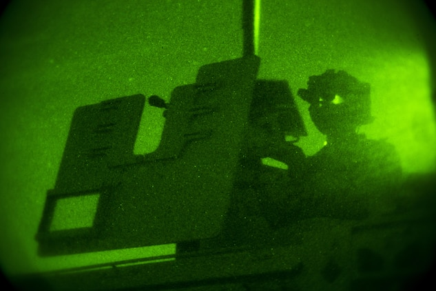 A Marine with Company C, 1st Marine Raider Battalion, Marine Corps Forces, Special Operations Command provides security during a night raid aboard Marine Corps Base Camp Pendleton, Calif., Oct. 9, 2015. Marine Special Operations Company C spent the first phase of their three-phase Company Collective Exercise practicing Foreign Internal Defense aboard Marine Corps Base Camp Pendleton, Calif., Oct. 5-8.
