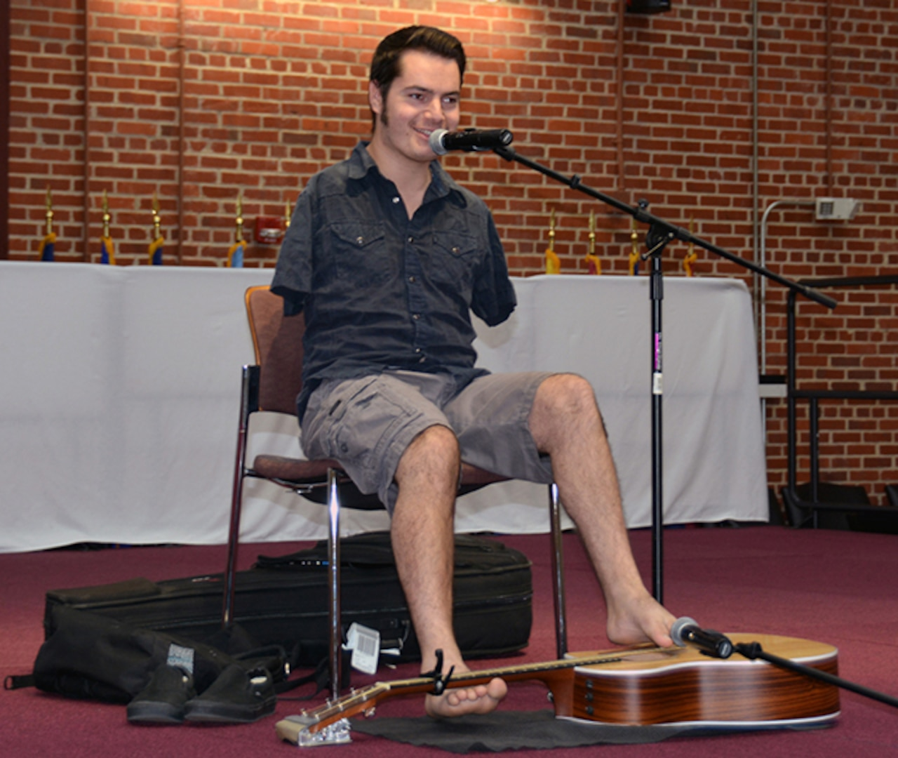 National recording artist George Dennehy shares his experience of growing up without arms during his performance as part of the National Disability Employment Awareness Month program at the Lotts Conference Center on Defense Supply Center Richmond, Virginia, Oct. 19, 2015.