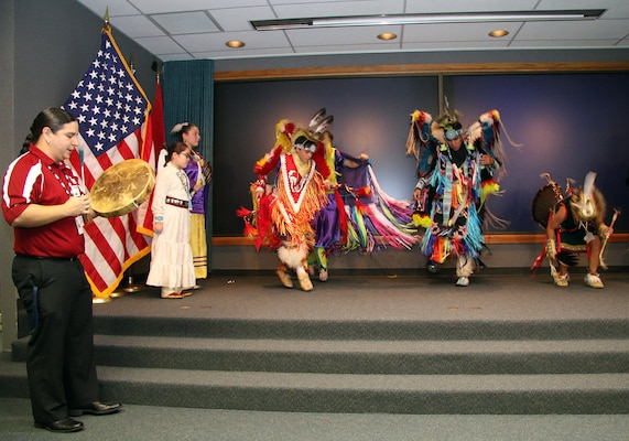 Mr. Mark Bolin, Academic Advisor for Owasso Public Schools Indian Education, beats a drum for the Owasso Indian Education Dance Group during a ceremony held Nov. 2, 2015 at the Tulsa District U.S. Army Corps of Engineers office.  The Tulsa District held the ceremony in recognition of National American Indian Heritage Month which is celebrated throughout the month of November 2015.