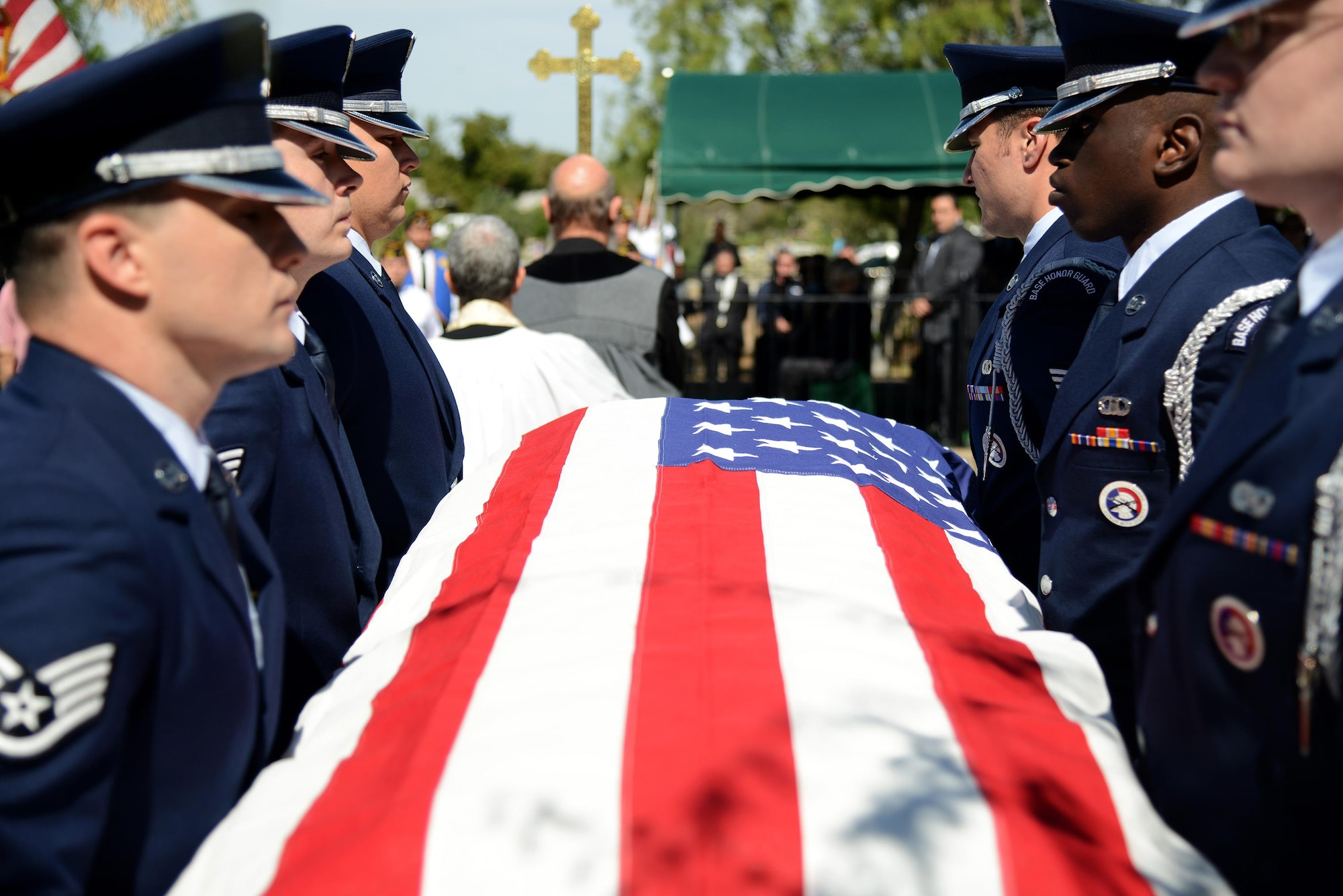 The Laughlin Honor Guard carries the casket of retired Maj. Gen. Homer Lewis in Eagle Pass, Texas, on Oct. 28, 2015. The body bearers carry the fallen to the gravesite while keeping the casket perfectly level and showing no visible signs of strain; to ensure military bearing is maintained at all times. (U.S. Air Force photo by Tech. Sgt. Steven R. Doty)(Released)