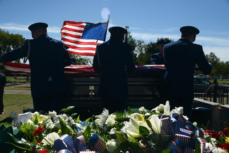 "The Laughlin Honor Guard places the flag over retired Maj. Gen. Homer Lewis's casket in Eagle Pass, Texas, on Oct. 29, 2015. Major General Homer I. ""Pete"" Lewis passed away peacefully at his home in Eagle Pass, Texas, Oct. 21, 2015 at the age of 96. His military decorations and awards include the Legion of Merit, Air Medal and the Air Force Outstanding Unit Award Ribbon. (U.S. Air Force photo by Airman 1st Class Brandon May)(Released)"