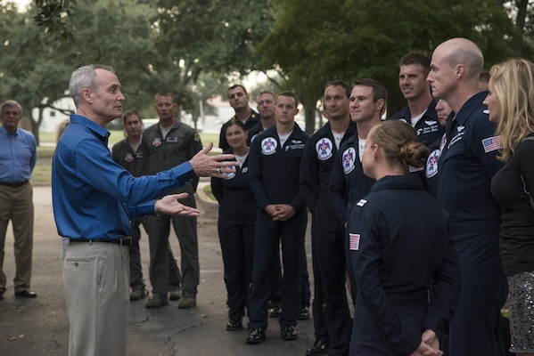 Lt. Gen. Darryl Roberson, commander of Air Education and Training Command, welcomes members of the U.S. Air Force Thunderbirds for a birthday celebration for retired Lt. Col. Richard Cole, Doolittle Raider, Oct. 30, 2015, at Joint Base San Antonio-Randolph, Texas.   The reception afforded General Roberson and attendees an opportunity to interact with an individual who represents a linkage to Air Force heritage. (U.S. Air Force photo by Airman 1st Class Stormy Archer/Released)