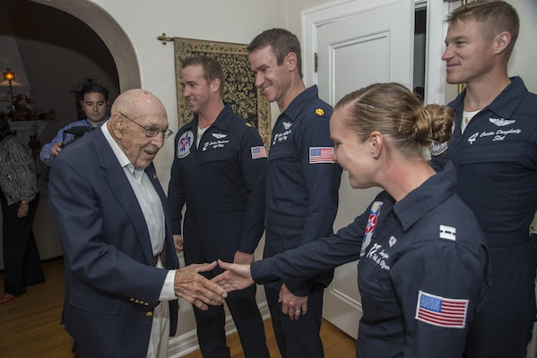 "Retired Lt. Col. Richard Cole, Doolittle Raider, shakes hands with members of the U.S. Air Force Thunderbirds at his 100th birthday celebration Oct. 30, 2015, at Joint Base San Antonio-Randolph. The Doolittle Raiders were a group of 80 men who served under the command of Gen. James ""Jimmy"" Doolittle.  The Raiders conducted a bombing mission on Japan April 18, 1942, in retaliation for the attack on Pearl Harbor. (U.S. Air Force photo by Airman 1st Class Stormy Archer/Released)"