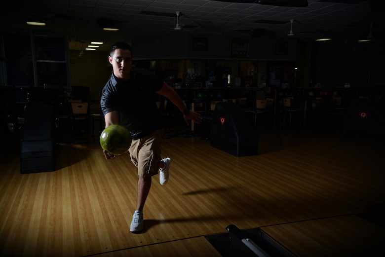 Senior Airman Javier Perez, 47th Medical Support Squadron diagnostic imaging technologist, poses at Cactus Lanes Bowling Center on Laughlin Air Force Base, Texas, Oct. 16, 2015. When not in uniform, the second place winner of the 2015 USBC Texas State tournament, singles division, is practicing his passion at the bowling center, preparing for his next bowling tournament. (U.S. Air Force photo by Airman 1st Class Ariel D. Partlow) (Released)