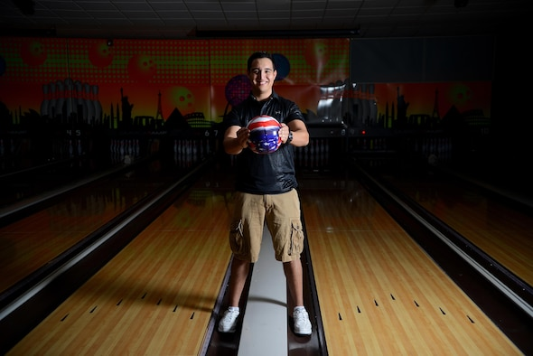 Senior Airman Javier Perez, 47th Medical Support Squadron diagnostic imaging technologist, poses at Cactus Lanes Bowling Center on Laughlin Air Force Base, Texas, Oct. 16, 2015. Perez's hobby in bowling grew into a passion that has followed him to adulthood.  (U.S. Air Force photo by Airman 1st Class Ariel D. Partlow) (Released)