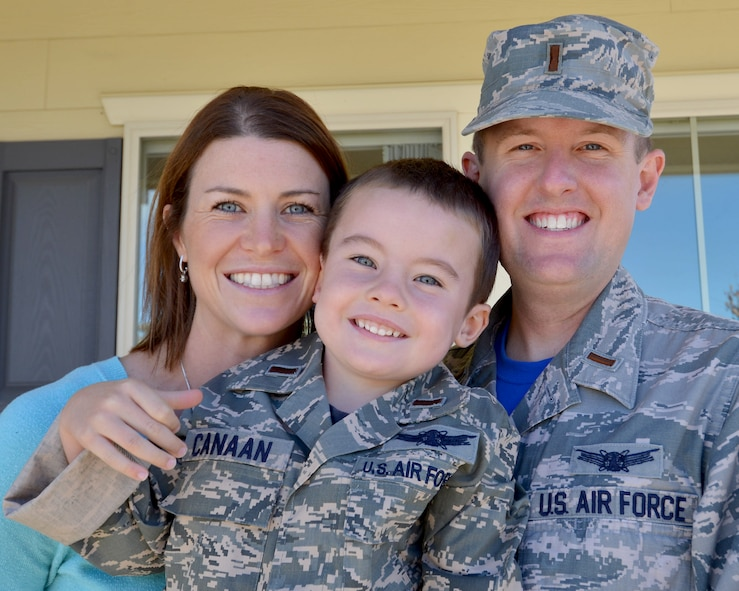 Andrew Canaan smiles with his parents, Janell and 2nd Lt. John Canaan, outside of their home Oct. 23, 2015, at Schriever Air Force Base, Colorado. Andrew's father works for the 1st Space Operations Squadron and Andrew hopes to one day join the military and work in space just like his dad. (U.S. Air Force photo/Staff Sgt. Debbie Lockhart)
