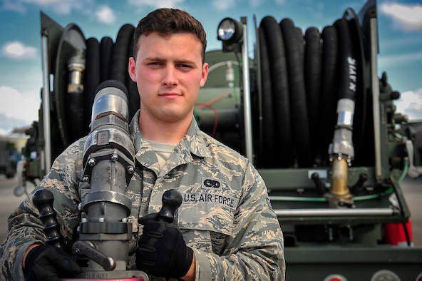 Senior Airman Caleb Cano, 6th Logistics Readiness Squadron fuels type 3 hydrants operator, stands in front of a beta-international R-12 fuels truck at MacDill Air Force Base, Fla., Oct. 29, 2015. Cano is a Magnolia, Texas, native and has been working fuel distribution as a hydrants operator for three years at MacDill. (U.S. Air Force photo by Senior Airman Ned T. Johnston/Released)