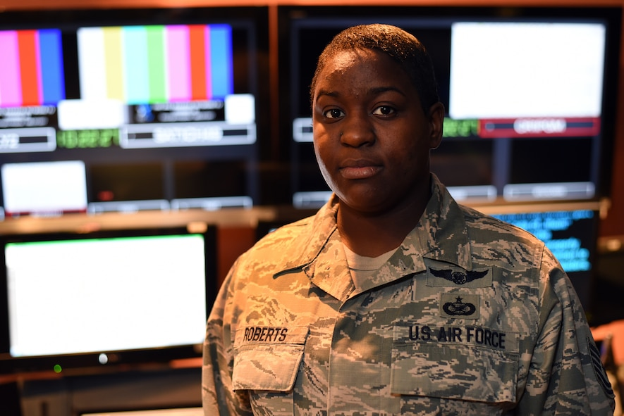 MCGHEE TYSON AIR NATIONAL GUARD BASE, Tenn. - Tech Sgt. Chalanda Roberts poses for a photo Nov. 2, 2015, inside the broadcast control room at the I.G. Brown Training and Education Center. Roberts served for five years as a regular Air Force technical director for the Air National Guard's satellite enlisted professional military education. (U.S. Air National Guard photo by Master Sgt. Mike R. Smith/Released)
