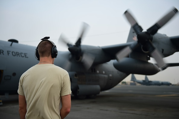 Senior Airman Aaron Hayes, 737th Expeditionary Airlift Squadron loadmaster, conducts pre-flight checks at an undisclosed location in Southwest Asia, Oct. 29, 2015. The 737th EAS mission is to provide airlift support throughout the area of responsibility for Operation INHERENT RESOLVE. (U.S. Air Force photo by Staff Sgt. Jerilyn Quintanilla)