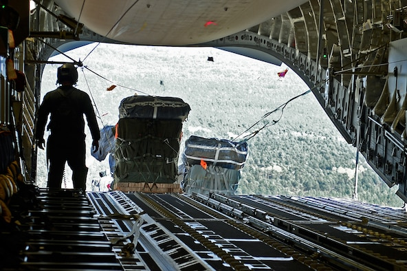 Cargo for the 82nd Airborne Division is air-dropped out the back of a C-17 Globemaster III, Oct. 29, 2015, over North Carolina during Joint Operation Access Exercise 16-1. The 82nd ABD was training as part of a global response force, which is a joint force that can deploy and have service members on the ground anywhere in the world within 96 hours. (U.S. Air Force photo/Senior Airman Divine Cox)