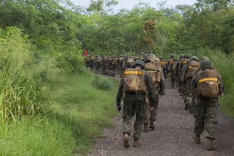 U.S. Marines with Special Purpose Marine Air-Ground Task Force-Southern Command take part in a 7 mile unit hike at Soto Cano Air Base, Honduras, Oct. 1, 2015. SPMAGTF-SC is a temporary deployment of Marines and Sailors throughout Honduras, El Salvador, Guatemala, and Belize with a focus on building and maintaining partnership capacity with each country through shared values, challenges, and responsibility. (U.S. Marine Corps Photo by Cpl. Stephanie Cervantes/Released)