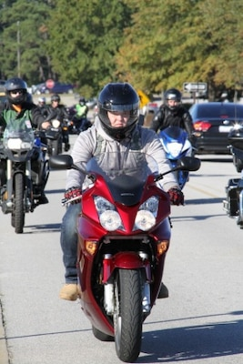 Army Pvt. Kaine Delancy, 19, from Perryville, Md., departs the 1st TSC headquarters area on Fort Bragg, N.C., to participate in the quarterly motorcycle mentorship ride, Oct. 30, 2015. U.S. Army photo by Elizabeth Gerhart