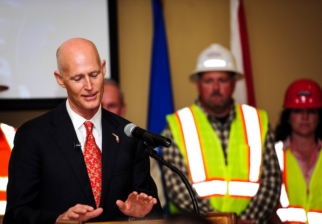 Florida Gov. Rick Scott speaks during a ceremony celebrating the completion of the U.S. 98/Cody Avenue interchange at Hurlburt Field, Fla., Nov. 2, 2015. The project elevated the U.S. 98 travel lanes above Cody Avenue to create a grade-separated interchange where traffic destined for Hurlburt accesses the gate via on- and off- ramps. (U.S. Air Force photo by Senior Airman Meagan Schutter/Released)