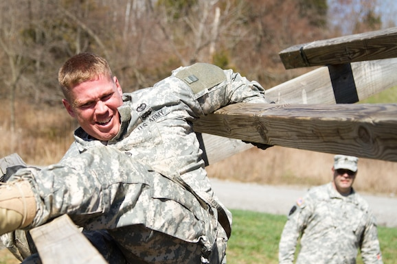 "Staff Sgt. Andrew Fink, 409th Area Support Medical Company, 307th Medical Brigade, 807th Medical Command, a native of Cook, Minn., and a candidate in the 807th Medical Command Best Warrior competition, picks his way through ""The Weaver"" obstacle at the Wendell H. Ford Training Center near Greenville, Ky. March 23. Fink won the 807th Medical Command Best Warrior noncommissioned officer catagory.  He'll compete at the US Army Reserve Best Warrior competition this May.  (US Army Photo by Sgt. 1st Class Adam Stone)"