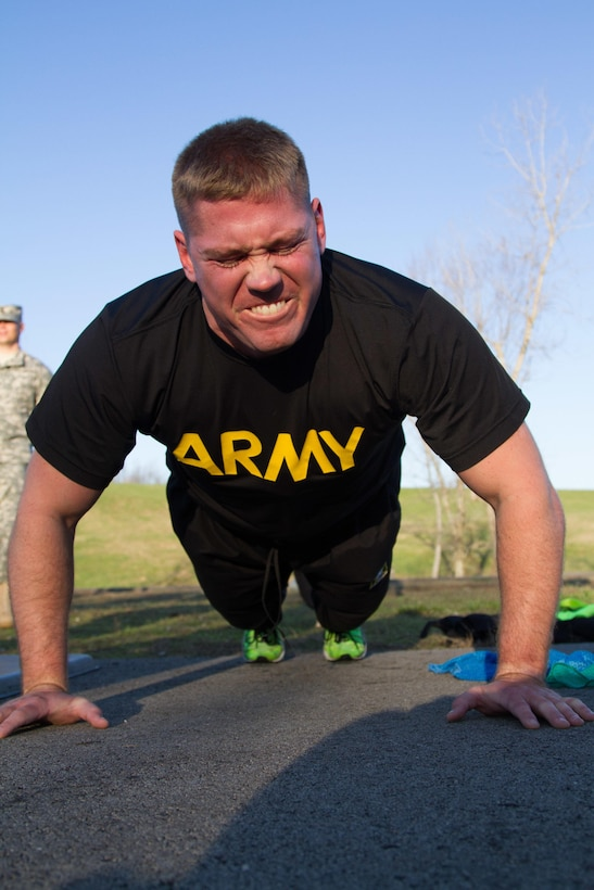 Staff Sgt. Andrew Fink, 409th Area Support Medical Company,  307th Medical Brigade, 807th Medical Command and a native of Cook, Minn., completes one of his many push-ups during the army physical fitness test for the 807th Medical Command's Best Warrior Competition at Wendell H. Ford Training Center near Greenville, Ky. March 23. Fink won the 807th Medical Command Best Warrior noncommissioned officer category.  He'll compete at the US Army Reserve Best Warrior competition this May.  (US Army Photo by Sgt. 1st Class Adam Stone)