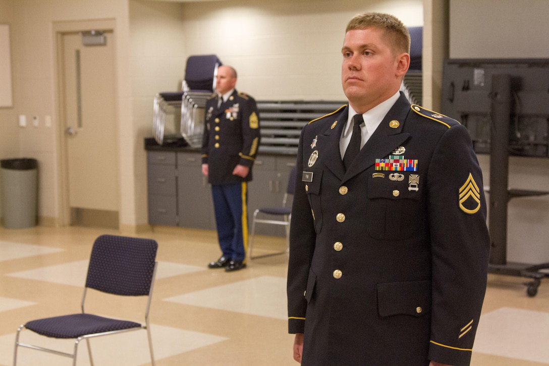 Staff Sgt. Andrew Fink, 409th Area Support Medical Company, 307th Medical Brigade, 807th Medical Command, a native of Cook, Minn., and a candidate in the 807th Medical Command Best Warrior competition, stands at attention while five sergeants major inspect his awards and uniform fit. Fink won the 807th Medical Command Best Warrior noncommissioned officer category.  He'll compete at the US Army Reserve Best Warrior competition this May.  (US Army Photo by Sgt. 1st Class Adam Stone)