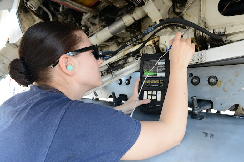 Airman 1st Class Adriana Van Wyk, 56th Equipment Maintenance Squadron nondestructive inspection technician, performs an eddy current test on an F-16 Fighting Falcon at Luke Air Force Base, Arizona, Oct. 30, 2015. The test checks for problems that may compromise the aircrafts structural integrity. (U.S. Air Force photo by Senior Airman James Hensley)