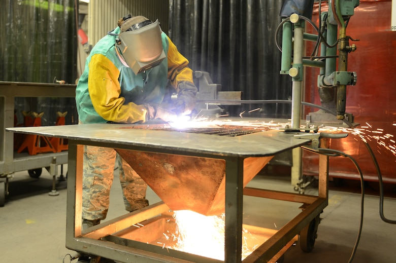 Senior Airman Rachel White, 56th Equipment Maintenance Squadron metals technology journeyman, uses a plasma cutter on a piece of scrap metal at Luke Air Force Base, Arizona, Oct. 30, 2015. Metals technology technicians work mostly on aerospace ground equipment and case by case equipment. (U.S. Air Force photo by Senior Airman James Hensley)