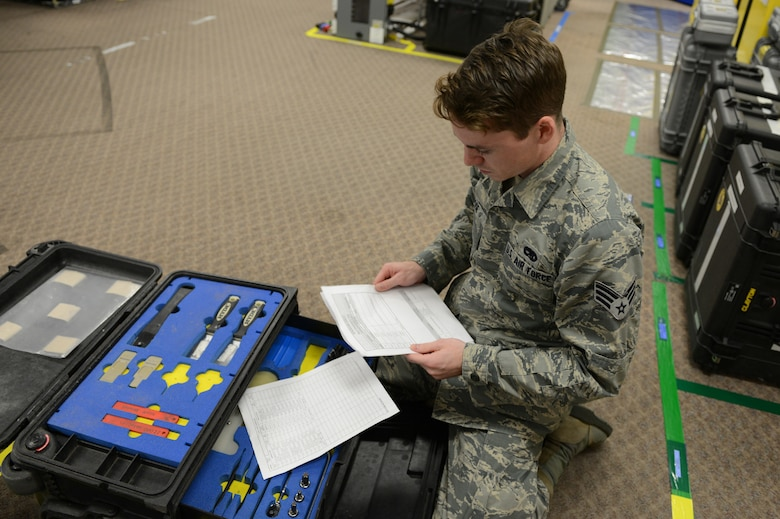 Senior Airman Joshua Rose, 56th Equipment Maintenance Squadron low observable aircraft structural maintenance journeyman, inspects a low observable dispatch box at Luke Air Force Base, Arizona, Nov. 2, 2015. Dispatch boxes need to be inspected prior to signing them out for use and upon return to keep track of equipment and ensure cleanliness. (U.S. Air Force photo by Senior Airman James Hensley)