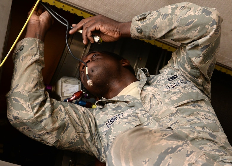 Senior Airman Lorenzo Bennett, 12th Aircraft Maintenance Unit RQ-4 Global Hawk dedicated crew chief, ensures an RQ-4's components are installed correctly Oct. 29, 2015, at Beale Air Force Base, California. The aircraft being worked on recently arrived at Beale to conduct a non-destructive inspection. Beale is used as the maintenance depot for the U.S. Air Force's RQ-4 fleet. (U.S. Air Force photo by Airman 1st Class Ramon A. Adelan)