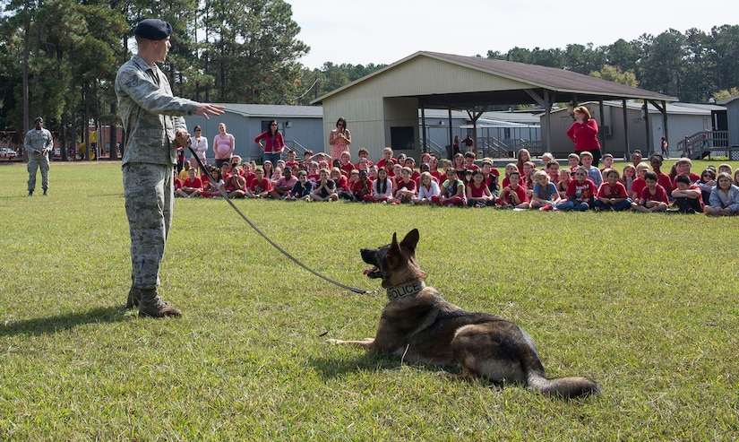Staff Sgt. Konnor Torkelson, 628th Security Forces Squadron military working dog handler, explains how his dog, Hulk, listens only to his commands at Marrington Elementary School on Joint Base Charleston – Naval Weapons Station, S.C., on Oct. 29, 2015. The 628th SFS traveled to MES to raise awareness of what illegal substance abuse can do are during Red Ribbon Week. (U.S. Air Force photo/Airman 1st Class Thomas Charlton)