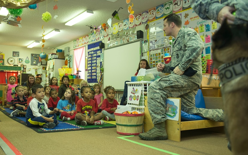 Staff Sgt. Kyle Shaugnessy, 628th Security Forces Squadron military working dog instructor, speaks to Dee Donnahoo's pre-school class about the dangers of drugs during Red Ribbon Week at Marrington Elementary School on Joint Base Charleston –Weapons Station, S.C., on Oct. 29, 2015. Shaugnessy has been with the military working dog program for four years. (U.S. Air Force photo/Airman 1st Class Thomas Charlton)