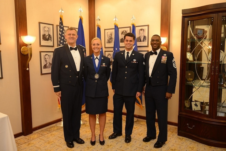 Gen. Frank Gorenc and Chief Master Sgt. James Davis, U.S. Air Forces in Europe and Air Forces Africa command team, pose for a photo with Senior Airman Shabree Heasell and her husband at the 2014 Outstanding Airmen of the Year banquet at Ramstein Air Base, Germany. Senior Airman Shabree Heasell was one of only 10 chosen across the Air Force for this brand new program. Each major command commander was given the opportunity to select just one enlisted Airman from their command to attend officer training school. (Courtesy photo)