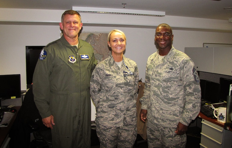 Gen. Frank Gorenc and Chief Master Sgt. James Davis, U.S. Air Forces in Europe and Air Forces Africa command team, congratulate Senior Airman Shabree Heasell, USAFE-AFAFRICA imagery analyst, on her selection for the Senior Leader Enlisted Commissioning Program Sept. 29, 2015 at Ramstein Air Base, Germany. Senior Airman Shabree Heasell was one of only 10 chosen across the Air Force for this brand new program. Each major command commander was given the opportunity to select just one enlisted Airman from their command to attend officer training school. (Courtesy photo)