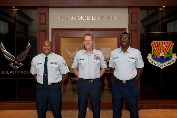 Chief Master Sgt. Matthew Lusson, 6th Air Mobility Wing command chief, stands with Staff Sgt. Matthew Smith, 6th Maintenance Squadron quality assurance inspector, and Senior Airman Herbert Hart, 6th Aerospace Medicine Squadron ophthalmology technician , before Shadow Day at MacDill Air Force Base, Fla., Oct. 8, 2015. This program gives top-notch Airmen an opportunity to shadow Chief Lusson for a day and witness first-hand what it means to lead in the world's greatest Air Force. (U.S. Air Force photo by Senior Airman Jenay Randolph/Released)
