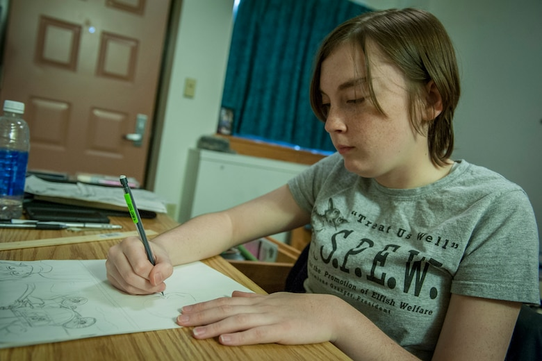 PETERSON AIR FORCE BASE, Colo. – Airman 1st Class Abby Morris, 21st Operations Support Squadron airfield management apprentice, works on a manga story during her off-time in her dorm Nov. 2, 2015. Morris began drawing when she was just 8 years old and is currently working on five different stories. (U.S. Air Force photo by Senior Airman Rose Gudex)